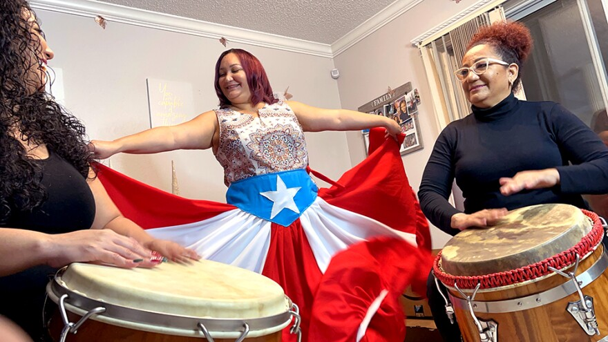 Barbara Liz-Cepeda (center) performs with her sister Caridad Cepeda (left) and their mother Tata Cepeda (right) who are visiting from Puerto Rico. All three women are involved with promoting Bomba and Plena through dance classes and community events.