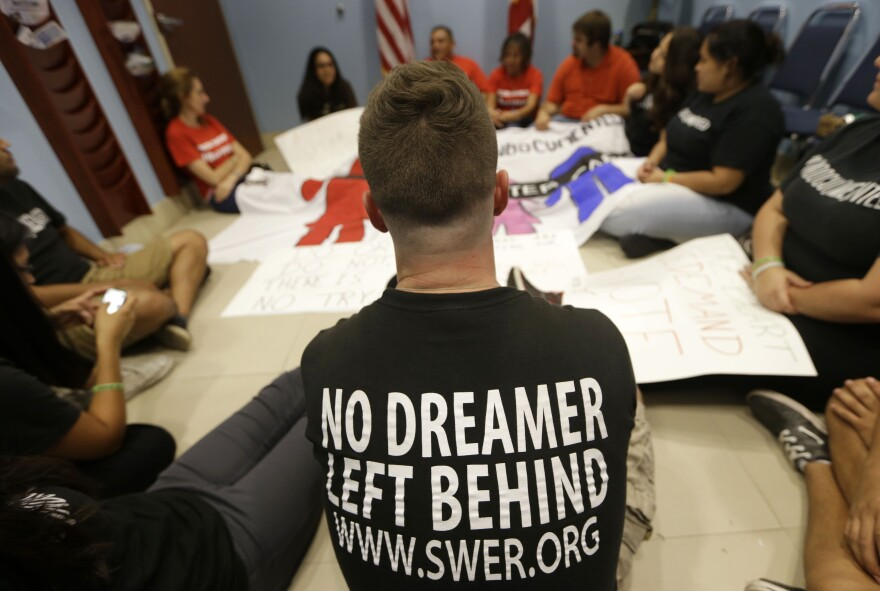 Demonstrators supporting an immigration overhaul stage a sit-down protest at the offices of Rep. Mario Diaz-Balart, R-Fla., on Oct. 11.