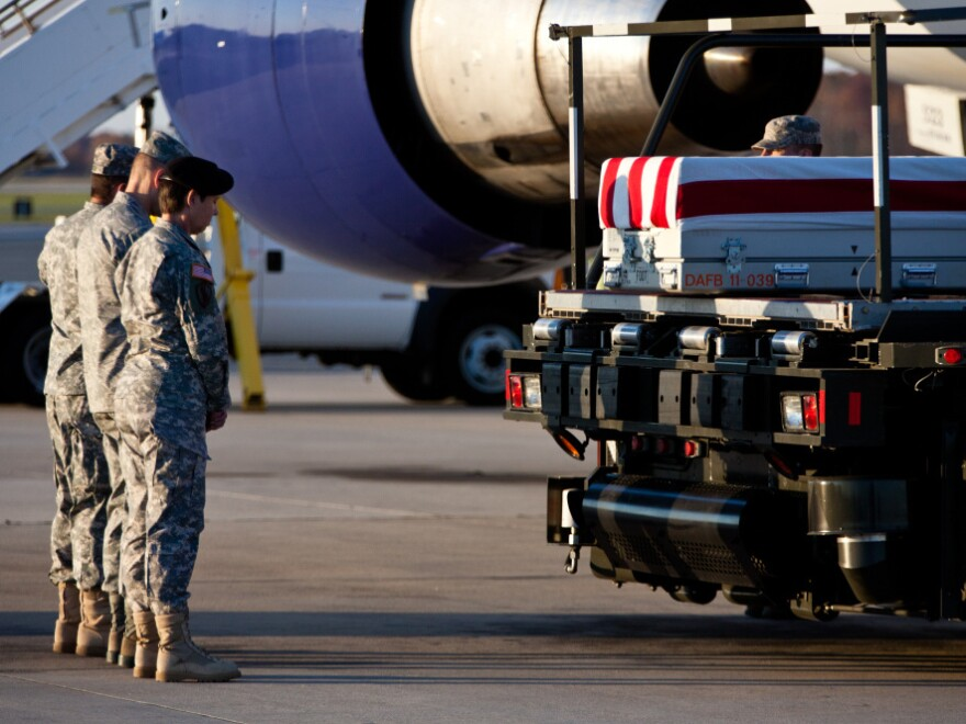 The remains of a U.S. Army private arrive at Dover Air Force Base for a transfer ceremony last November. The mortuary at Dover Air Force Base has come under accusations that body parts of the nation's war dead were cremated and the ashes dumped in a Virginia landfill.