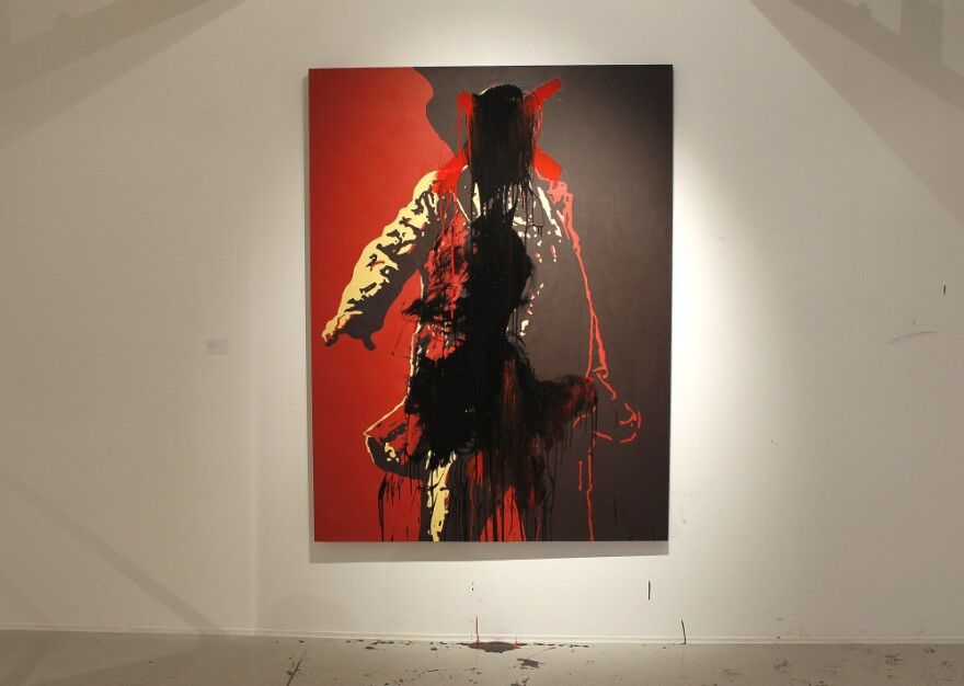 The controversial portrait of South African President Jacob Zuma painted by Brett Murray stands defaced at the Goodman Gallery in Johannesburg, South Africa on Tuesday.