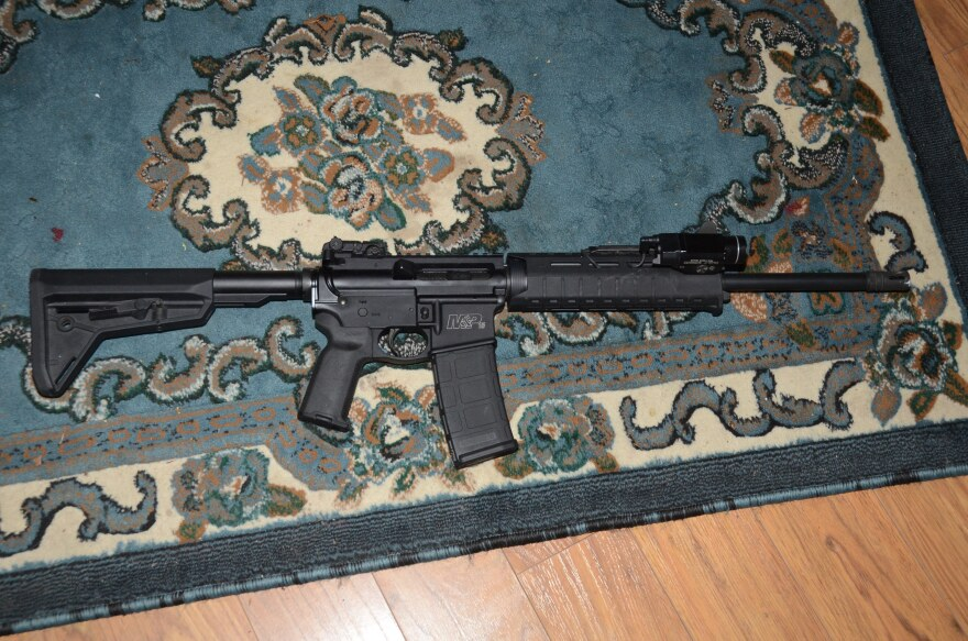 Police say Brabham shot officers with this rifle just inside the threshold of his home.