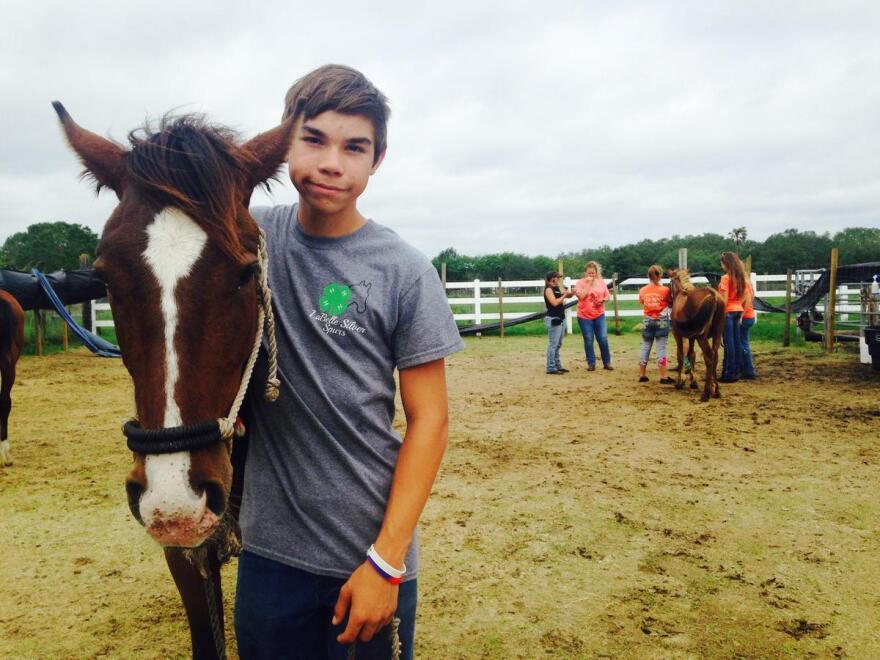 Patrick Taylor, 14, with his wild horse Roper.
