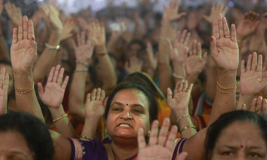 Members of the Jain community in Mumbai, India, protest a High Court order that banned <em>santhara</em>, a practice of fasting until death.