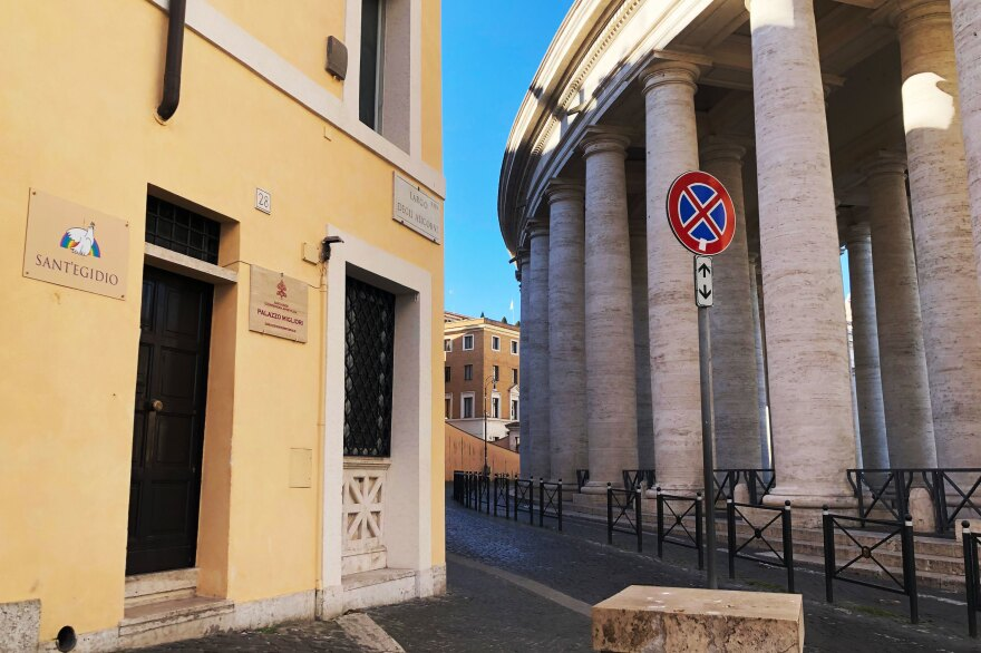 The 19th century Palazzo Migliori (left) is situated on prime real estate near St. Peter's Square. The colonnade encircling the square can be seen at right.