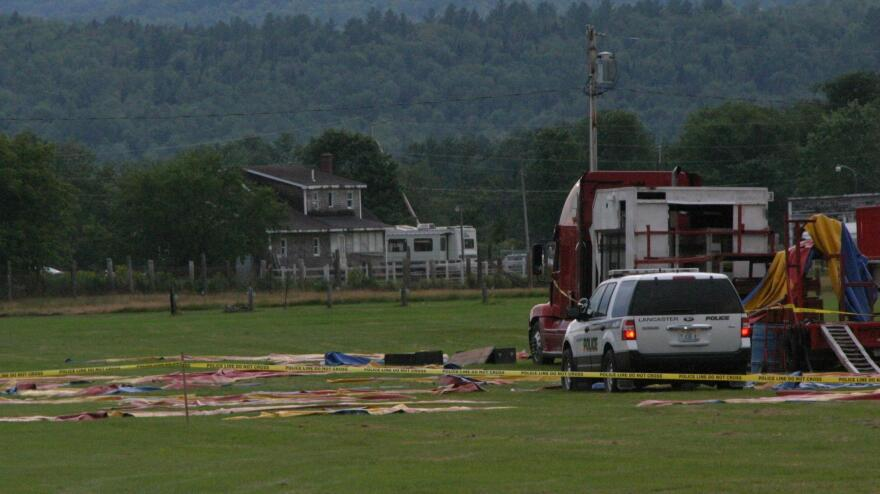 Officials are investigating the cause of a tent collapse that killed two people and injured more than a dozen others.