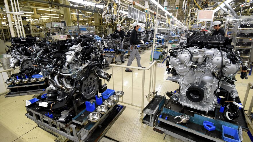 Employees work at the main assembly line of V-6 engines at a Nissan Motor plant in Iwaki, Japan, in 2016.