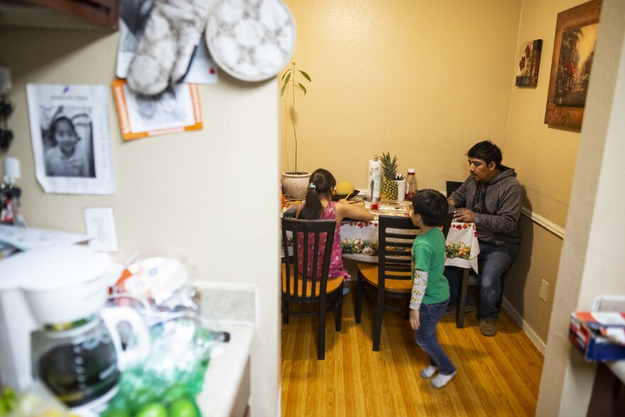 Jose Perez with their children, Marina and Jose Marcelo, in their apartment in North Austin.
