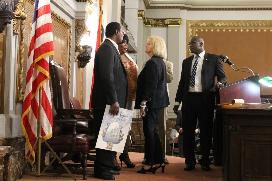 St. Louis Mayor Lyda Krewson speaks with Smith's parents after the Board of Aldermen approved a resolution honoring his memory.
