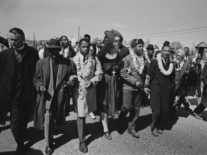John Lewis (third from the left) joins Rev. Martin Luther King as they begin the march from Selma to Montgomery in March 1965.
