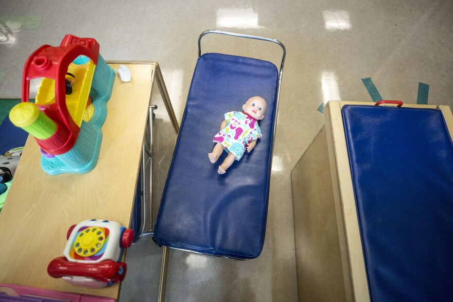 A doll on a toy stretcher at Dell Children's hospital.
