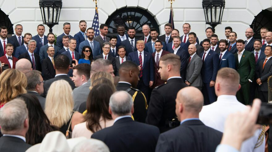 President Trump poses with the 2018 World Series Champion Boston Red Sox at the White House on Thursday.