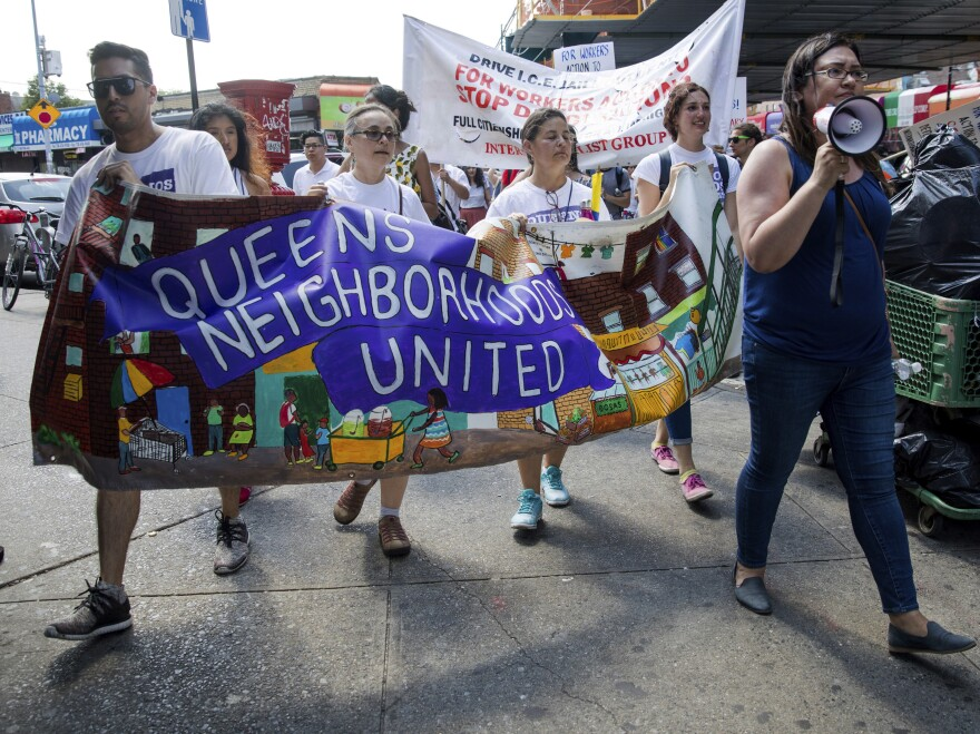 In New York City, hundreds of people march in Queens on Sunday in opposition to the Trump administration's plans to continue with raids to catch immigrants in the country illegally.