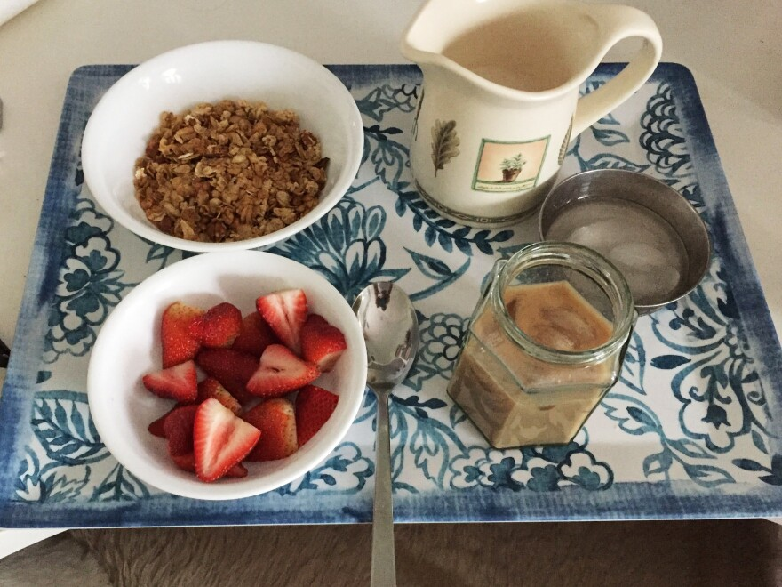 Room service: Granola and strawberries served with iced coffee.