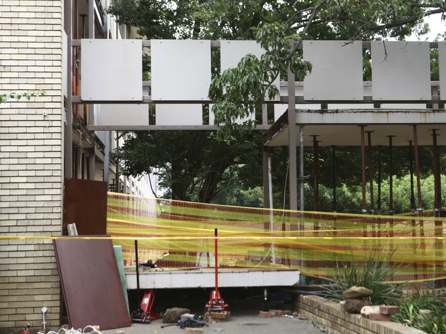 Police tape cordons off the site of a walkway collapse at the Driehoek High School in Vanderbijlpark, South Africa, Friday.