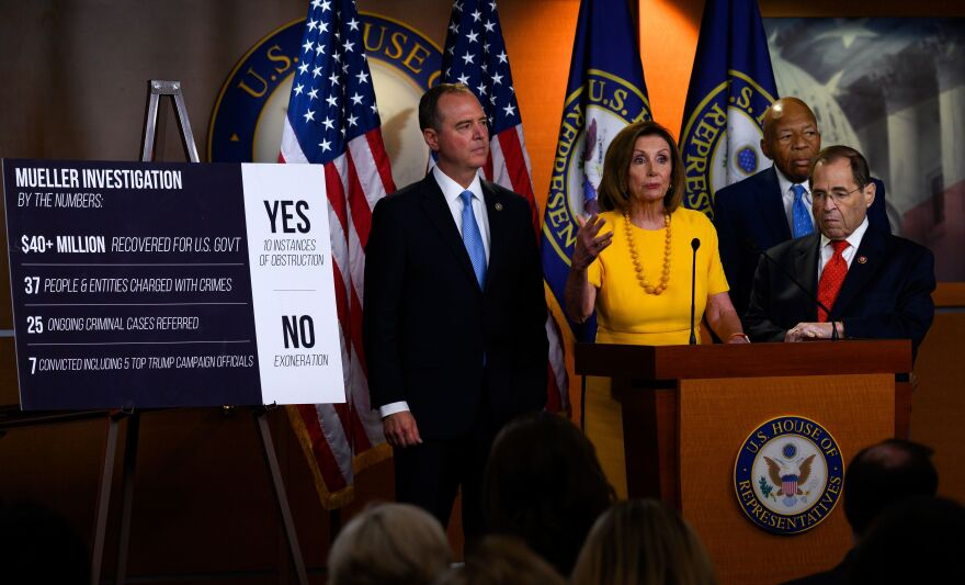 House Speaker Nancy Pelosi holds a news conference with Democratic committee chairmen Adam Schiff, Elijah Cummings and Jerry Nadler after Mueller's testimony on Wednesday evening.