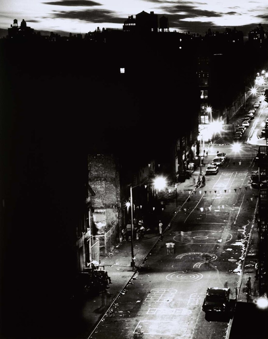 """Night View,"" 1961 — ""It's a photograph of my block ... [I was] showing that in the midst of this poverty there was extraordinary beauty. And rarely, rarely did we ever see it. So I was pleased when people did see it ... I just remember looking through the viewfinder and thinking once I let the shutter release go. I felt it, I knew there was something unique and special about what just occurred."""