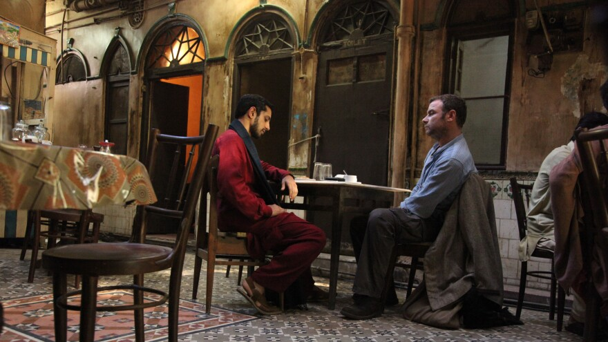 A probing conversation between Changez (Riz Ahmed), a young Pakistani activist, and Bobby (Liev Schreiber), an American agent, forms the core of <em>The Reluctant Fundamentalist</em>.