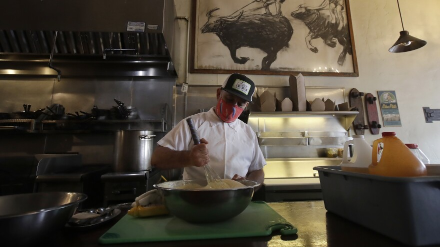 Cory Obenour, chef and co-owner of the Blue Plate restaurant in San Francisco, prepares takeout and delivery orders. The restaurant received funds from the Paycheck Protection Program, according to The Associated Press.