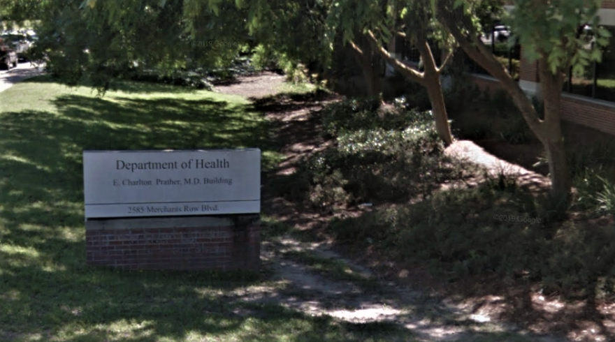 sign in front of department building