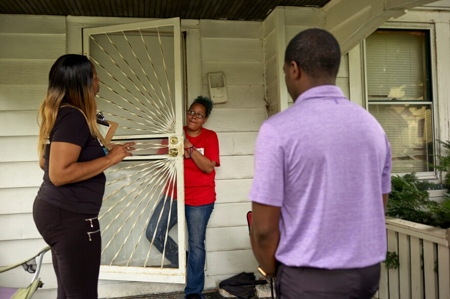 Wisconsin State Rep. David Crowley, right, works with Keisha Robinson, left, of BLOC, Black Leaders Organizing for Communities as he takes part in a silent canvass where Mr. Crowley is only allowed to listen to community members like Quiana Jasper, center, Aug. 7, 2018 Milwaukee.