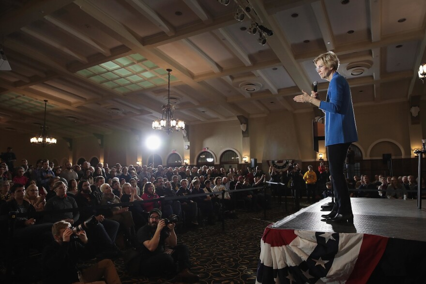 While Sen. Elizabeth Warren, seen speaking in Iowa, may be dominating the policy debate, there is little evidence that voters are rewarding politicians who flesh out their plans over others with strong personal brands.