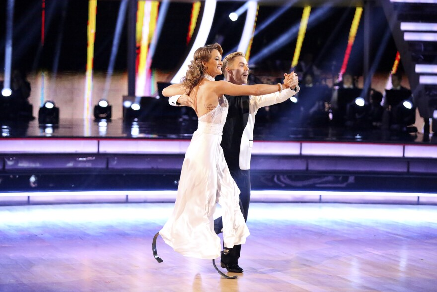 Amy Purdy, who lost both lower legs because of bacterial meningitis, performs with Derek Hough on <em>Dancing With The Stars</em>.