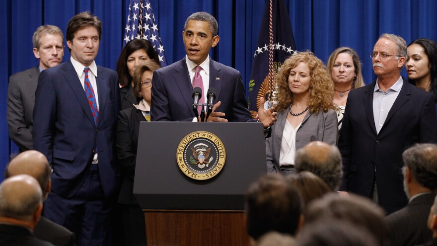 """President Obama, with millionaires and their assistants, makes a point on the """"Buffett Rule"""" in Washington, DC, Wednesday, April 11, 2012."""