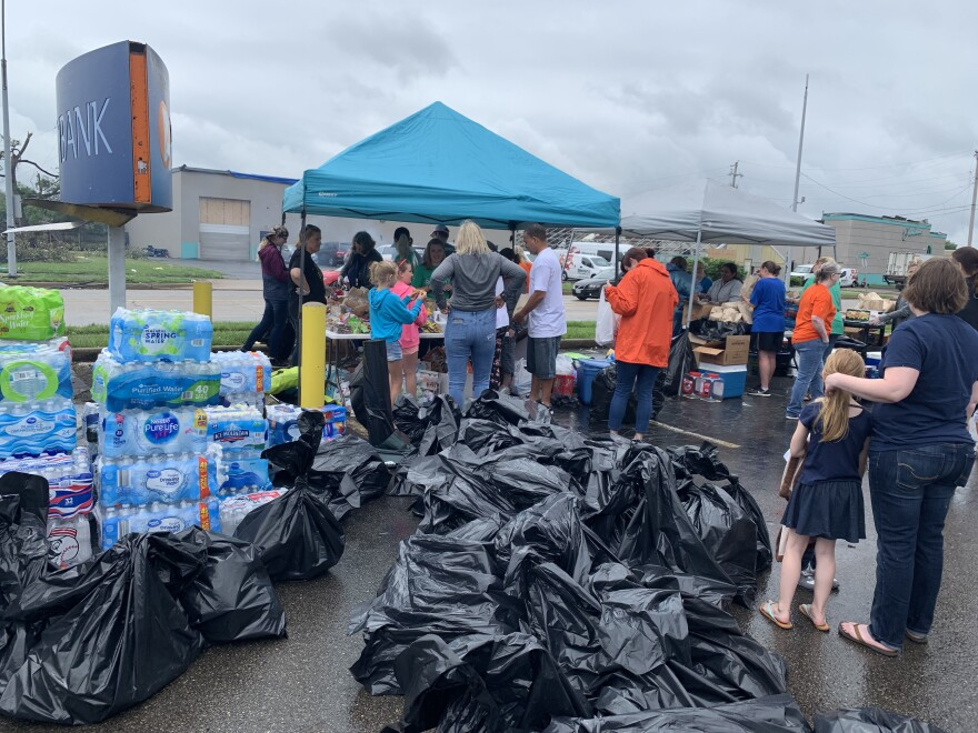 Volunteers with the Pathway School of Discovery collected trash bags full of donations and distributed free meals in Old North Dayton on Thursday.