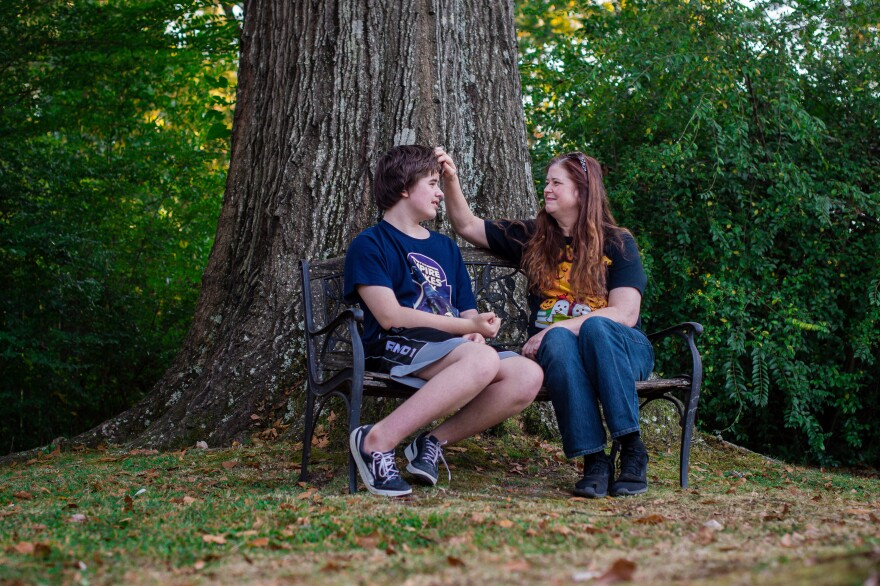 Ellen Griffin sits with her oldest son outside her home.