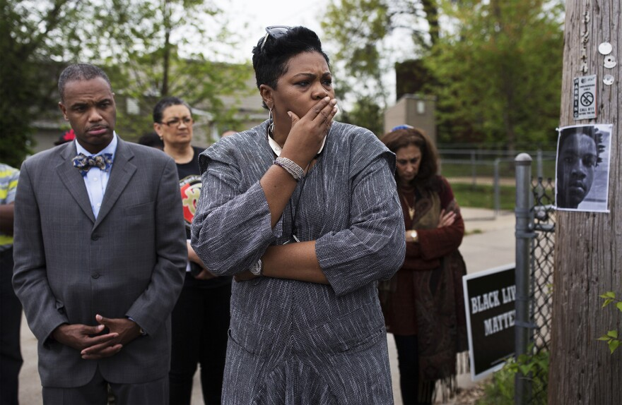 Rev. Traci Blackmon listens as activists call attendees to action.