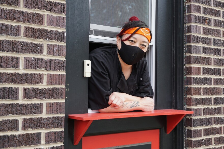 Melanie Meyer, owner of Tiny Chef, pops her head out the takeout window attached to her kitchen, which operates out of  the Silver Ballroom bar.