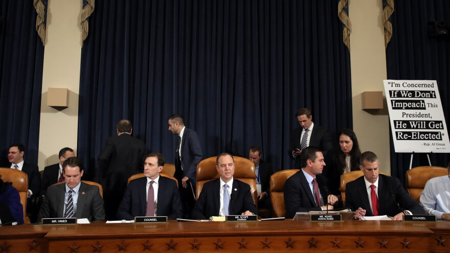 Daniel Goldman, attorney and director of investigations with the House Intelligence Committee (second from left); committee Chairman Adam Schiff, D-Calif; ranking member Rep. Devin Nunes, R-Calif.; and Steve Castor, counsel for the minority, hold the first public hearing of the impeachment inquiry on Capitol Hill on Wednesday.