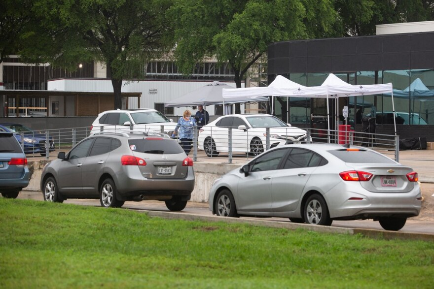 People wait in line for drive-up COVID-19 testing in Austin in March. Much of the testing done has been PCR testing, which is more accurate and takes longer to get results. But rapid antigen testing is growing in popularity.