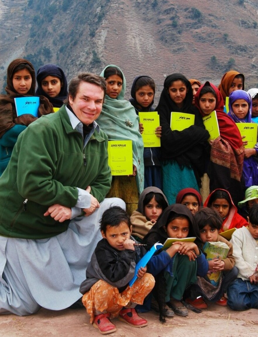 Greg Mortenson, the author of <em>Three Cups of Tea </em>and <em>Stone Into Schools</em>, poses with Nowseri schoolchildren in Azad Kashmir, Pakistan.
