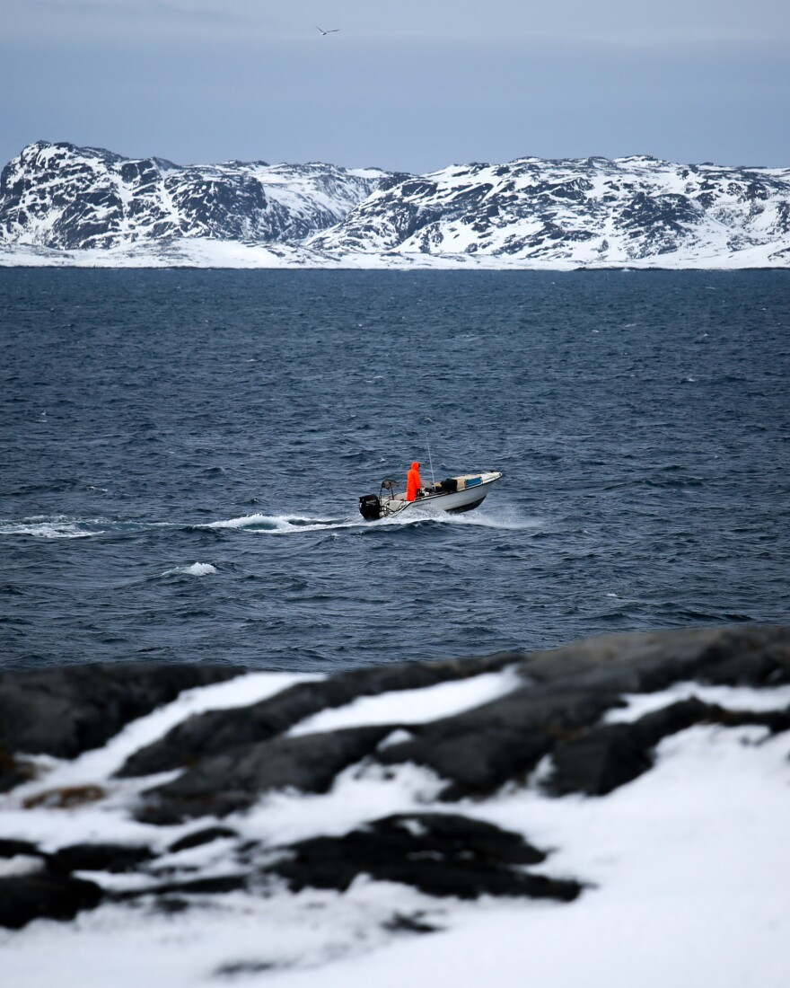 A hunter heads into the fjord that surrounds Nuuk.