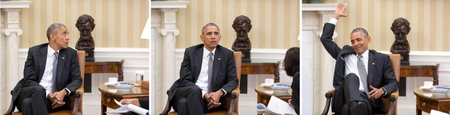 President Obama reacts Thursday as he is told of the Supreme Court's decision on the Affordable Care Act.