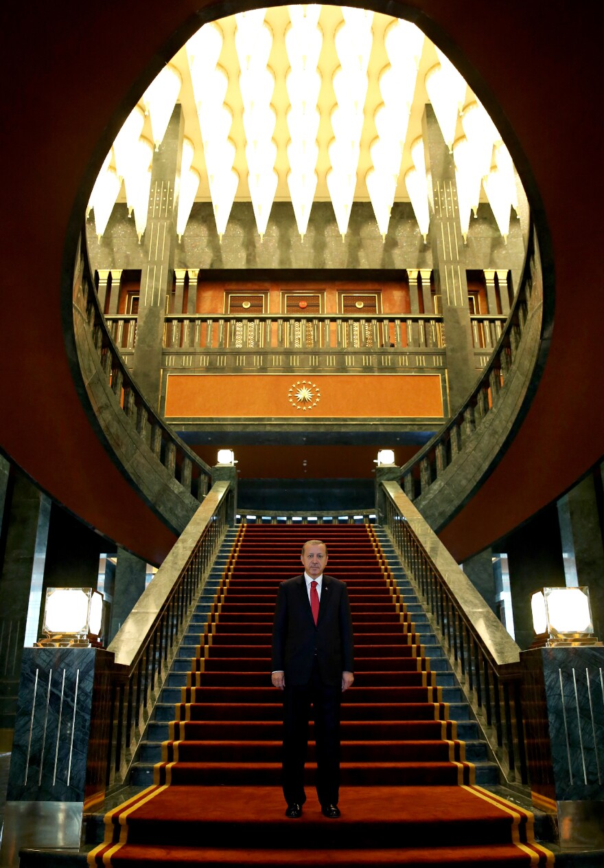 Erdogan stands in the newly built presidential palace in Ankara before the start of the 91st anniversary celebrations of the Turkish Republic on Oct. 29.