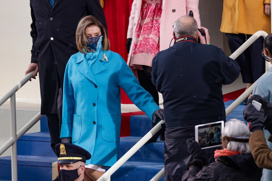 House Speaker Nancy Pelosi's brilliant blue coat appeared to have weathered a few snow flurries ahead of the inauguration ceremony.