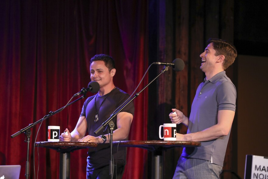 <em>Ask Me Another</em> guests Arturo Castro and Topher Grace at the Bell House in Brooklyn, New York.