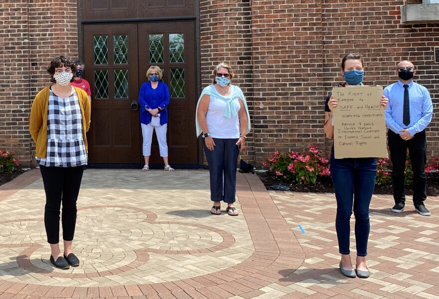 Members of UD Solidarity stand in front of the Chapel of the Immaculate Conception on the University of Dayton campus on July 14.