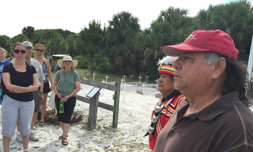 Bobby Henry, cultural adviser to the Seminole Tribe of Florida, stands next to Willie Johns, Chief Justice of the Seminole Courts, near a cemetery on Egmont Key. The island served as a detainment camp for Seminoles in the 1850s before being sent to the West.
