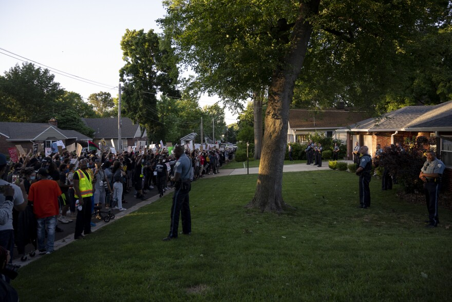 Protestors marched from the police station and gathered outside Florissant Mayor Tim Lowry's home during Wednesday's protest.