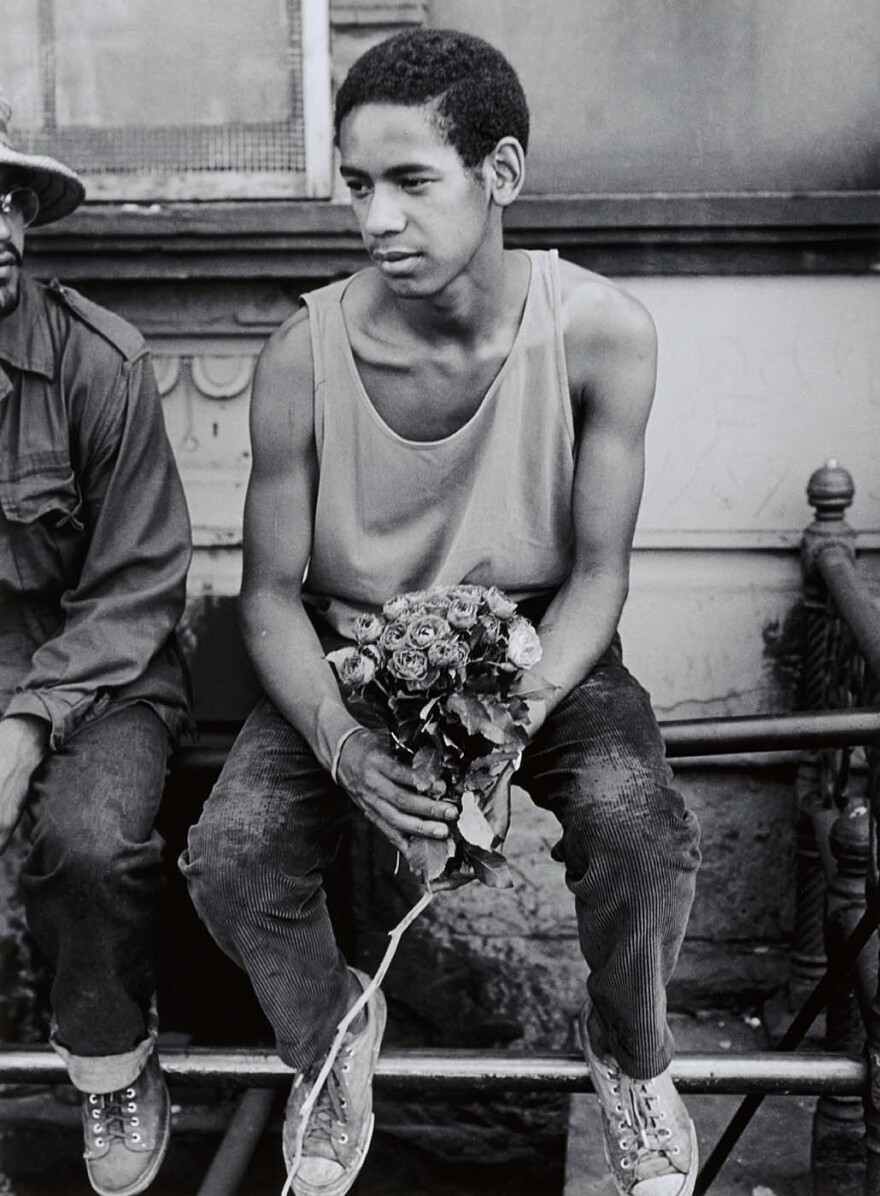 """Young Man with Roses,"" 1971 — ""Who are the flowers for? There's two stories. For his girlfriend, or for his mother. In East Harlem, you do not walk around with roses in your hand. If you do, you are a badass. This is no joke of a man. He's a gentle giant who wouldn't harm a fly. I think they were for his girlfriend, but it was easier for him to say they were for his mother."""