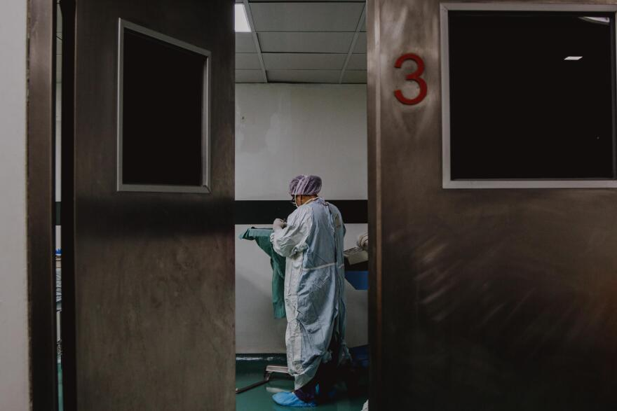 a photo of a healthcare worker in a hospital room