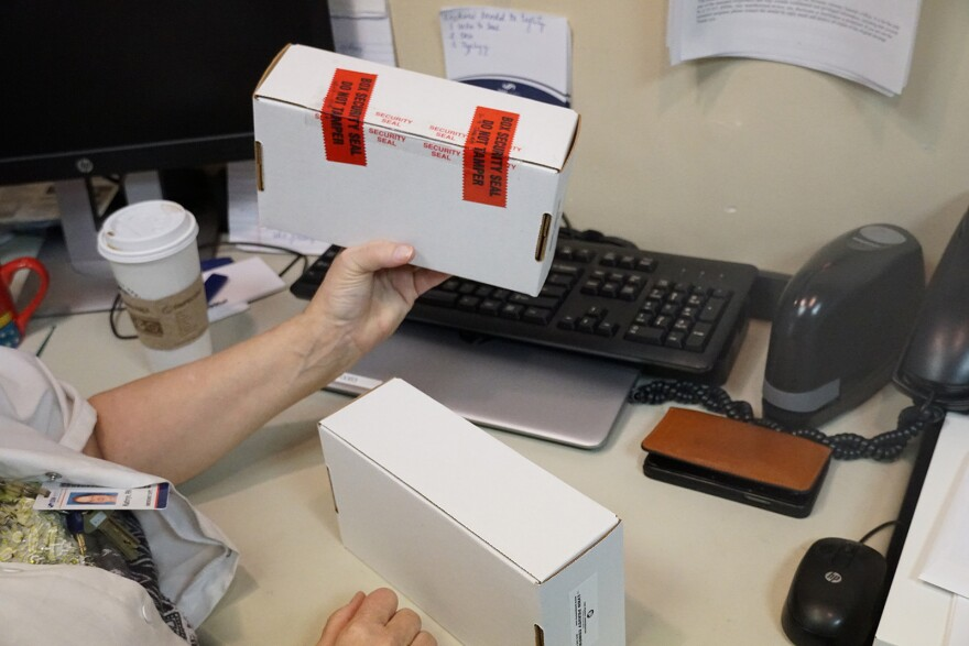 Kathy Howard shows what a rape kit looks like once it has been used and sealed. Sept. 27, 2019