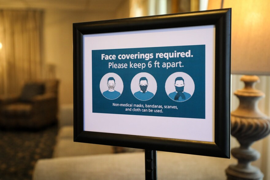 A sign requiring face coverings at Mission Funeral Home in Austin.