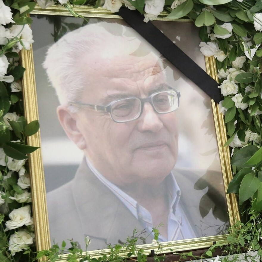 A portrait of Khaled al-Assad, is displayed during a ceremony in his memory at the National Museum on Aug. 23, 2015 in Damascus.