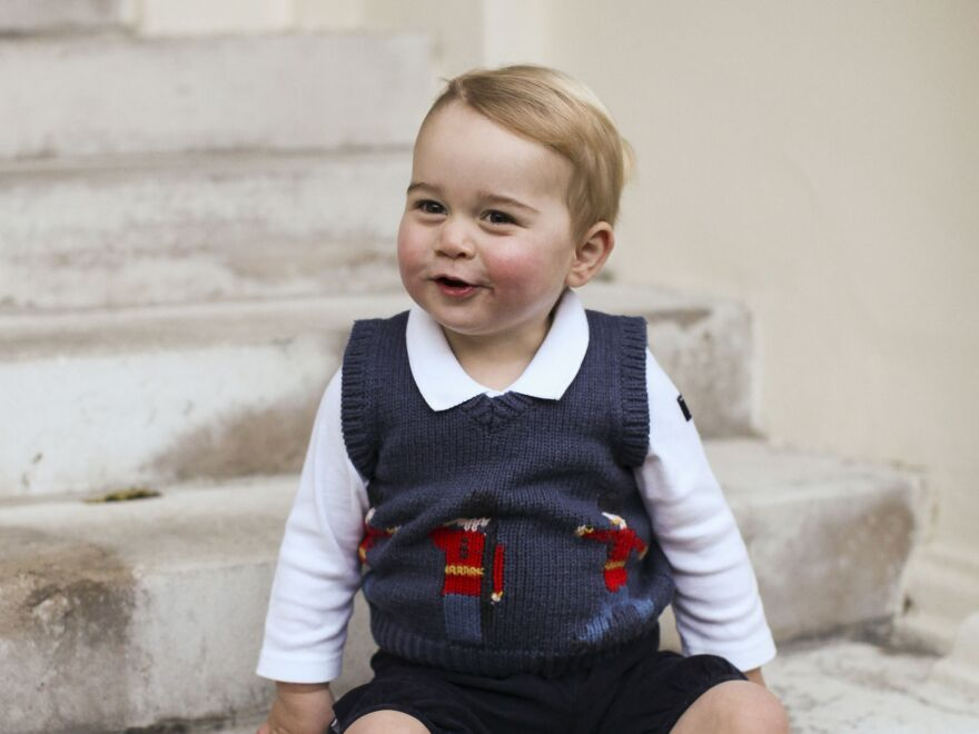 Official Christmas photo of Prince George, 1, taken in late November in a courtyard at Kensington Palace in London.