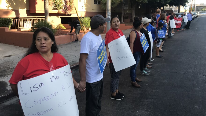 Tenants angry over what they say are greedy rent increases protest outside an apartment building in Los Angeles.