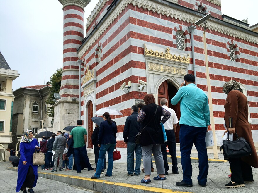 """Turks line up outside the Istanbul governor's office, one of the """"crisis management centers"""" set up for those who believe they were wrongly suspended, fired or arrested following the July 15 coup attempt."""